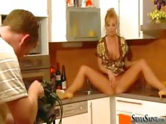 Silvia Saint backstage, shooting a sexy scene in a kitchen