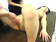 Stacked Asian beauty has two masseuses fingering her pussy