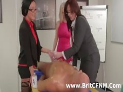 Group of CFNM women give man handjob in office