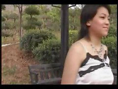 Asian woman with nice hooters poses and plays with herself