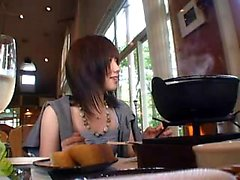Cute Asian babe is followed around before she eat and flash