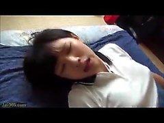 Pretty Asian teen in school uniform
