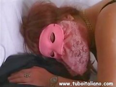 Amateur Italian brunette in a mask rubs her pussy until she gets help