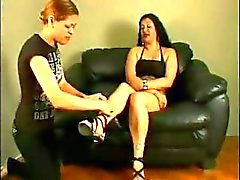 Brunette having a smoke gets her dirty feet licked and sucked