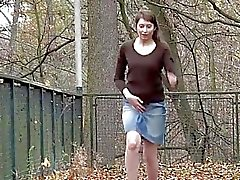 Hairy girl lifts her skirt and pisses outdoors
