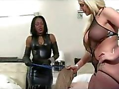 Two mistresses are taking turns fucking with their passive slave