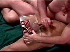 CBT I crush my bottoms ball in a vise and jack his big cock.