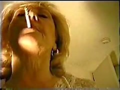 Mature smoking & sucks POV cock