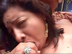 Chubby Indian babe with big ass on bed sucking and fucking two hard cocks