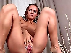 Beautiful sweetie is pissing and rubbing shaved honey pot