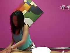 Asian masseuse caught jerking on spycam