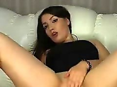 Seductive brunette gently masturbates and rubs her pussy wit