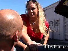 Big, blonde and beautiful Lilly West gets on her knees for some fellatio action