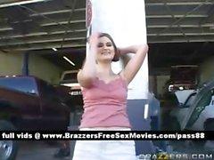 Superb blonde pornstar at a car workshop