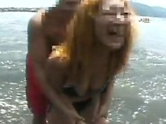 Bikini babes at the beach strut around and one shows nice b