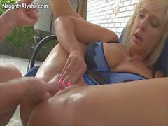 Busty blonde lesbians are toying and fisting their wet pussies
