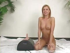 Blonde Ginger Lee is riding that sybian machine for an orgasm