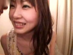Lovely Oriental girl with a cute smile has a guy kissing he