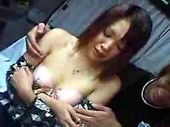 Delightful Oriental babe with lovely tits hangs on for a de