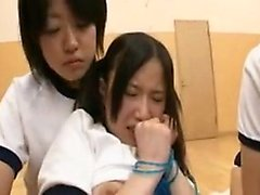 Pigtailed Japanese schoolgirl is made to find pleasure with