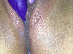 We-vibe in oozing pussy and fingering her ass.