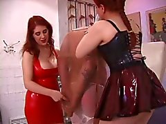 Felix the lucky slave is dominated by two sexy sluts on the floor