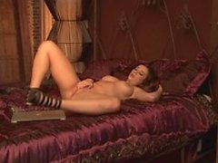 Horny Taylor Vixen masturbates erotically on her comfy bed