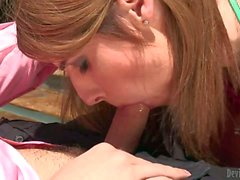 T-girl Amy Daly in bikini top gives blowjob by the pool