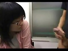 Fully dressed Asian girl with glasses teases and sucks a ha