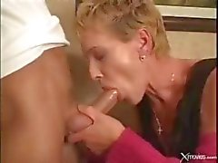 Short-haired mature blonde gets fucked by the young messenger at her office