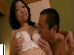 Naughty Asian mom with big boobs gets her peach fingered an