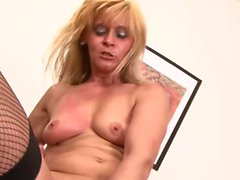 Hot MILF in fishnets gets blacked hard