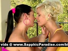 Lovely brunette and blonde lesbos kissing and having lesbo love