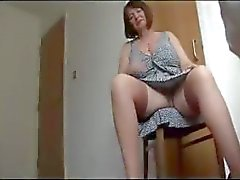 Busty, hairy mature chubby is stripping and posing on cam