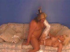 Blonde in a sexy outfit gets pounded on the sofa by a guy