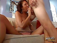 This gorgeous MILF gets double serviced