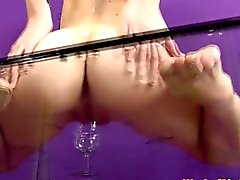 Clitpierced pissing babe dildofucking her box