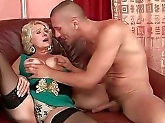 Busty fat granny in black stockings getting fucked