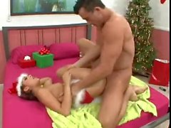 Audrianna Angel gives a footjob in Santa suit
