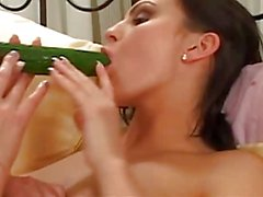 Two lesbians in lingerie with cucumber
