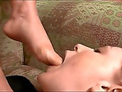 Mature mistress use lesbian foot slave