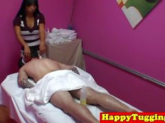 Busty asian masseuse cocksucks and tugs