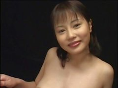 Horny Japanese beauty licks cum off a table after a hardcore face fucking shoot
