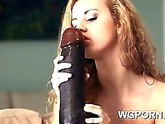 Petite blonde Jessie Rogers licking a huge black dildo