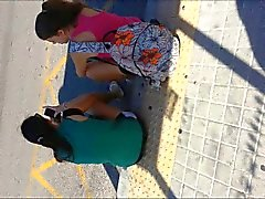 cum behind teens in bus stop