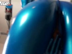 Kinky Fiona in blue latex showing her pussy slit
