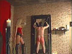 Blond mistress whipping bondage dude