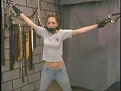 Bondaged slender a-cup brunette hair in face mask groped by s&m dom
