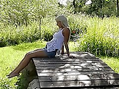 Blonde woman from Sweden touching clit
