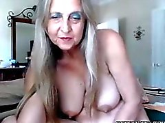 hot busty mature babe rubs pussy